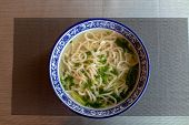 Noodle Soup. Chinese Cuisine. Homemade Noodles With Herbs. Chicken Stock With Noodles. poster