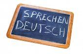 sentence sprechen deutsch, german is spoken, written on a chalkboard