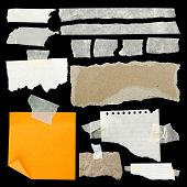 picture of cut torn paper  - Pieces of torn paper and adhesive tape on black - JPG
