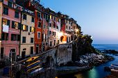 Village Of Riomaggiore In Cinque Terre Illuminated At Night, Italy