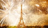 celebrating the New Year in Paris Eiffel tower with fireworks poster