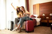 Traveling Girls Resting In A Hotel Room poster