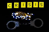 Illegal Drug Crisis Concept Showing Tablets, Handcuffs And The Message Crisis poster