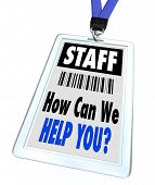 A badge and lanyard with printed pass reading Staff and How Can We Help You