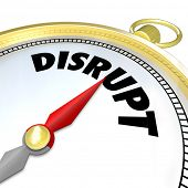 The word Disrupt on a compass symbolizing a new paradigm shift being applied to a traditional business model thanks to a revolutionary idea or technology
