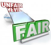 The words Fair and Unfair balanced on a see-saw, balance or scale to symbolize justice versus injustice in life
