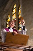 Priest preaching during mass on Sunday in an old church