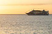 Cruise Ship Sails To Setting Sun