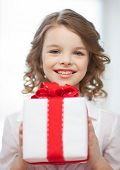 picture of beautiful pre-teen girl with gift box