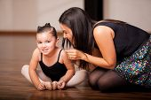 Little girl and her dance teacher