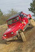 Red Car In A Difficult Terrain