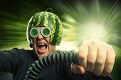 Bizarre man in a helmet from a watermelon riding fast
