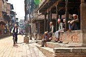 BHAKTAPUR - MAY 20 : Unidentified Tharu old men besides the street of Bhaktapur, Nepal on May 20, 20