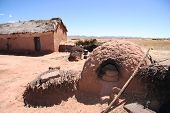 Traditional clay house with a outdoor oven in Bolivia