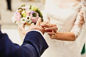 Holding hands with wedding rings