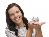 Mixed Race Woman Holding Small House Isolated on White Background.