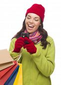 Mixed Race Woman Wearing Winter Clothing Holding Shopping Bags Texting On Cell Phone Isolated on Whi