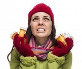 Sick Mixed Race Woman Wearing Winter Hat and Gloves Blowing Her Sore Nose and Holding Empty Medicine