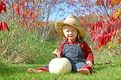 Smiling Country Boy Baby In Autumn Foliage