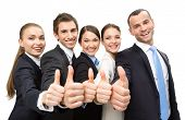 Group of thumbing up business people, isolated on white. Concept of teamwork and cooperation