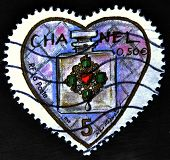 A stamp printed in France shows Chanel perfume in a heart