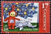 Guernsey - Circa 1998: A Stamp Printed In Guernsey Shows Po, A Teletubbies, Circa 1998