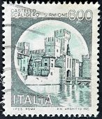 A stamp printed in Italy shows Scaligero Castle Sirmione italian series of castles