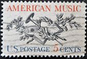 A Stamp Printed In Usa, Shows Lute, Horn, Laurel, Oak And Music Score