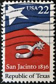 Stamp printed in USA shows spur star flag and the inscription