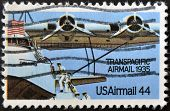 Stamp Shows Plane with inscription Transpacific airmail 50 years of first transpacific airmail line