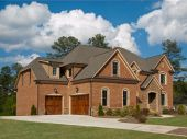 image of model home  - Luxury Model Home Exterior with cloudy sky - JPG