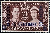 stamp printed in Great Britain showing an image of the coronation of George VI with queen Elizabeth