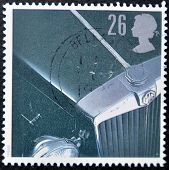 a stamp printed in the United Kingdom shows the bonnet of an MG motor car