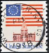 United States Of America - Circa 1975: A Stamp Printed In The Usa Shows Flag Over Independence Hall