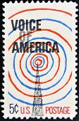 A Stamp Printed By Usa Shows A Radio Tower And Voice Of America