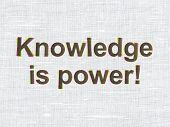 Education concept: Knowledge Is power! on fabric texture backgro