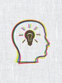 Finance concept: Head With Lightbulb on fabric texture backgroun