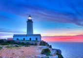 La Mola Cape Lighthouse Formentera at sunrise in Balearic Islands