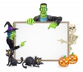 stock photo of frankenstein  - A Halloween sign with cartoon skeleton witch and Frankenstein monster all pointing at the center - JPG