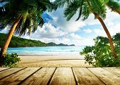 seychelles beach and wooden pier