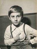 LODZ, POLAND, CIRCA FEBRUARY 1977: Vintage photo of little boy posing as Napoleon Bonaparte