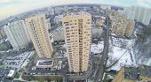 Many high residential buildings in neighborhood at winter. Aerial view
