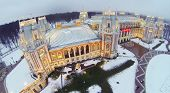 Illuminated Tsaritsyno Palace at winter evening in Moscow, Russia. Aerial view