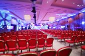 picture of illuminating  - Conference  hall with red chairs and colored illumination - JPG