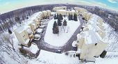 New townhouse village with cottages at winter. View from unmanned quadrocopter