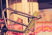 pic of carnival ride  - Detail of a carnival ride in subtle vintage tones - JPG