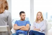 love, family, phychology and relationship problems concept - young couple with a problem at psychologist office