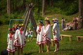 TERVENICHI, RUSSIA - JUL 7, 2013: Local people celebrated Ivan Kupala Day. The celebration relates to the summer solstice and includes a number of fascinating Pagan rituals.