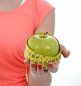 Happy Young Girl With Apple And Measure Tape In Diet Sucess