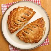 Two Cornish pasties on a plate